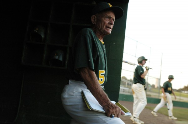 Husson College baseball coach John Winkin keeps an eye on his players during a spring training game at St. Leo University in St. Leo, Florida on March 17, 2006.