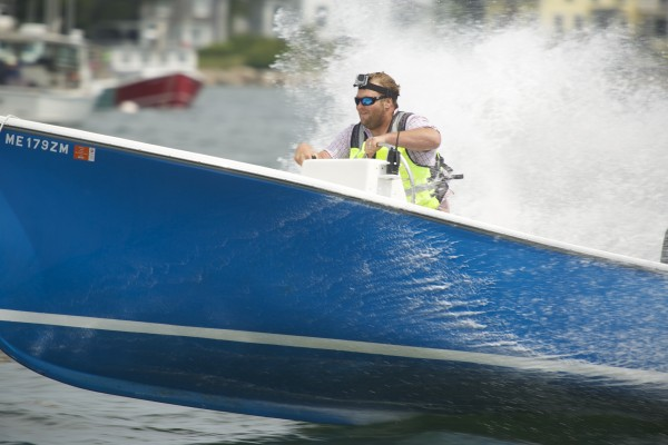 Marshall Spear crosses the finish line on &quotJ-Bird&quot to win the Class C Inboards, outboards or outdrives, 61 to 90 hp during the 2014 lobster boat races on Sunday in Stonington.