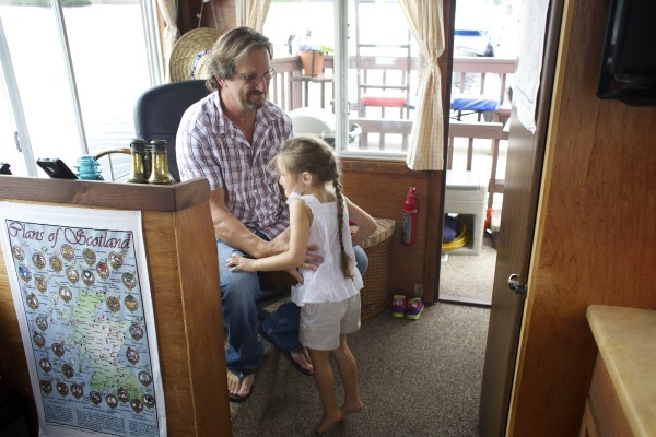 Guy Armstrong of Carmel picks up his granddaughter, Lily Wilcox, 5, on his houseboat he is mooring on the Bangor Waterfront throughout the summer months.