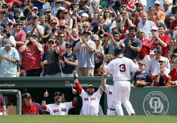 Boston's David Ross (3) is congratulated after a two-run home run against the Kansas City Royals in the fourth inning at Fenway Park in Boston Sunday. The Red Sox won 6-0.
