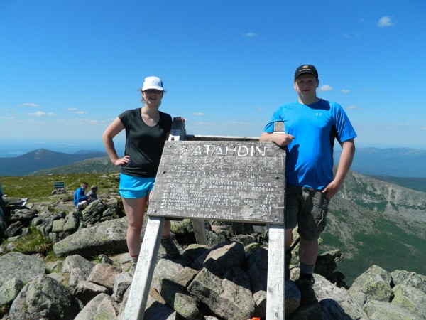 Rose Ross, 17, of Holden, and Justin Landry, 17, of Brewer, stand at the summit of Katahdin on June 27, 2014.