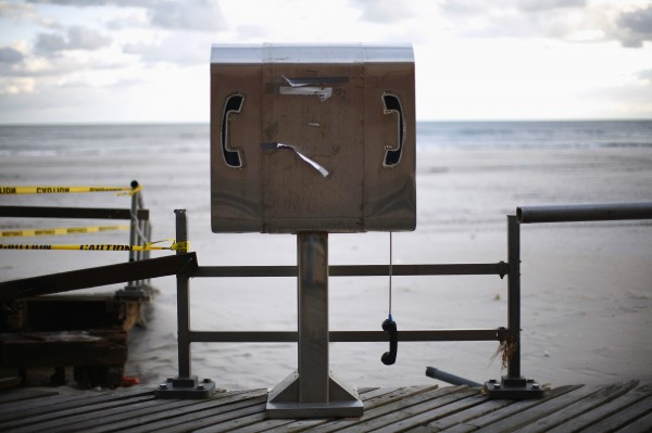 A damaged pay phone is seen on a boardwalk in the Rockaways section OF the Queens borough of New York in 2012.