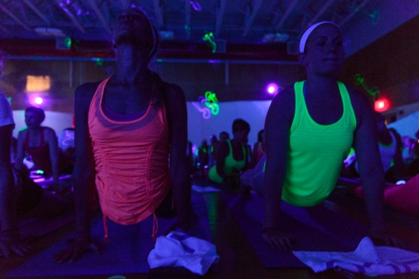 Upward facing neon. Black light yoga is &quotdancehall meets a sweat lodge meets a yoga class,&quot said instructor Halle Becker.