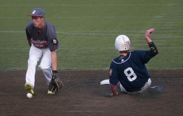 BANGOR, MAINE -- 07/26/14 -- Bangor's Ryan Brookings (right) slides safely to second past Trenton's Jon Phelps during a Zone 1 American Legion baseball state-qualifying game at Husson University in Bangor.