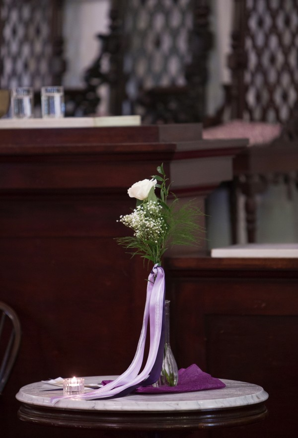 A special flower to memorialize the 30th anniversary of the death of Charlie Howard sits in the Unitarian Universalist Society in Bangor on Sunday.