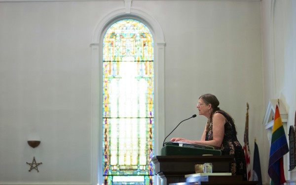 Unitarian Universalist Society member Laurie Cartier speaks to guests during a special Sunday service in Bangor to honor the 30th anniversary of the death of Charlie Howard.