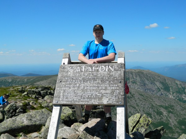 Justin Landry, 17, of Brewer, stands on Baxter Peak, the summit of Katahdin, on June 27, 2014.