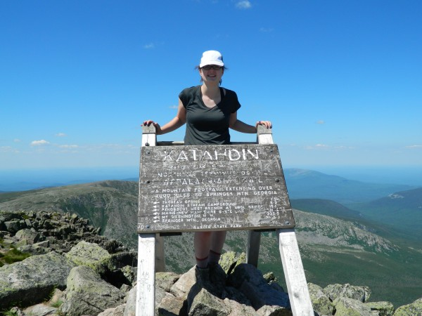 Rose Ross, 17, of Holden, stands on Baxter Peak, the summit of Katahdin, on June 27, 2014.