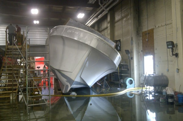 This boat at Millennium Marine was damaged and fell over when it filled with water after sprinklers were activated by a fire Wednesday morning.