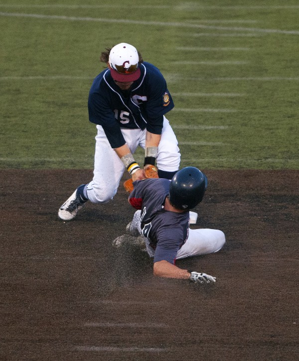 BANGOR, MAINE -- 07/26/14 -- Trenton's Finn McMahon (right) slides safely into second past Bangor's Sam Huston during a Zone 1 American Legion baseball state-qualifying game at Husson University in Bangor.