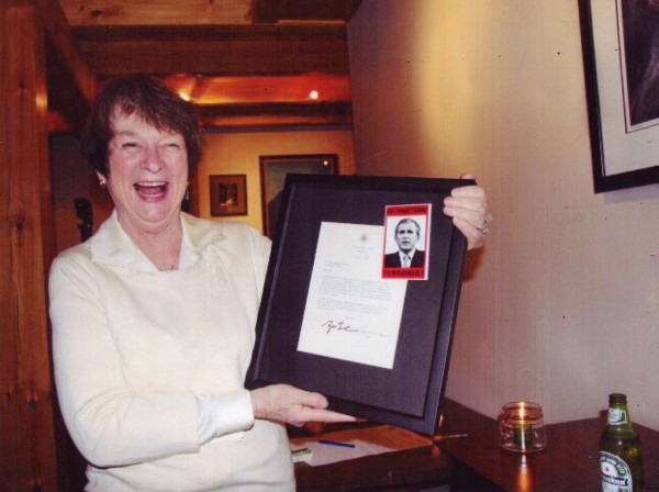 This undated photo shows Libby Mitchell laughing at a description of former President George W. Bush as an 'International Terrorist,' the Maine Republican Party said.