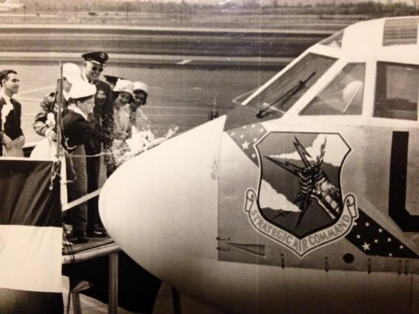 Representing the City of Bangor, Sherry Lowe christens an air force plane in 1964.