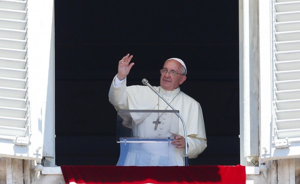 Pope Francis waves during his Sunday Angelus prayer in Saint Peter's square at the Vatican recently.