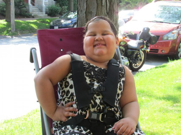 Desiray Gallerani, 7, received a new pediatric wheelchair Monday from the Robbie Foundation of Scarborough at her home on Middle Street in Portland.