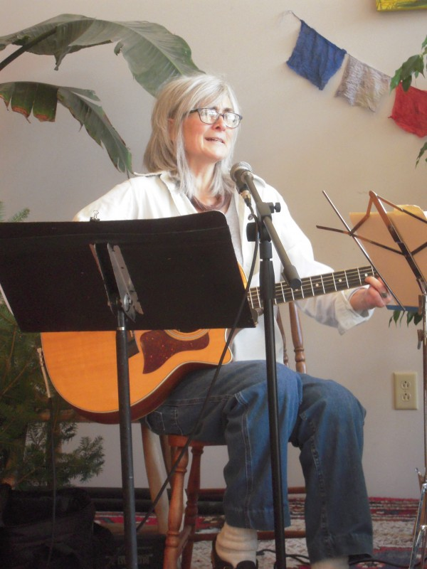 Singer-songwriter Carol Ayoob takes time from working to perform on the stage of her restaurant, The Whole Potato, in Presque Isle.