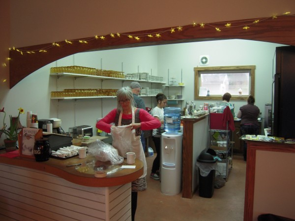 Carol Ayoob (foreground) works with her kitchen crew during the opening days of The Whole Potato Cafe and Commons in Presque Isle.