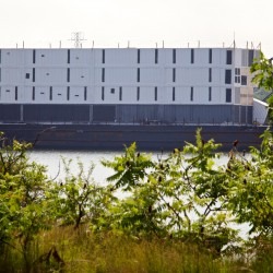 Floating prison? Movie set? Mystery continues to surround four-story structure being shipped to Portland