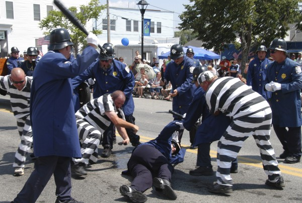 A Keystone Cop gets ambushed by a prisoner during an unruly portion of the &quotJust Cartooning Around&quot 2010 Annual Homecoming Parade in Lincoln.