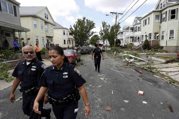 Boston Police Department officers investigate storm damage along Taft Street in Revere, Massachusetts, on Monday.