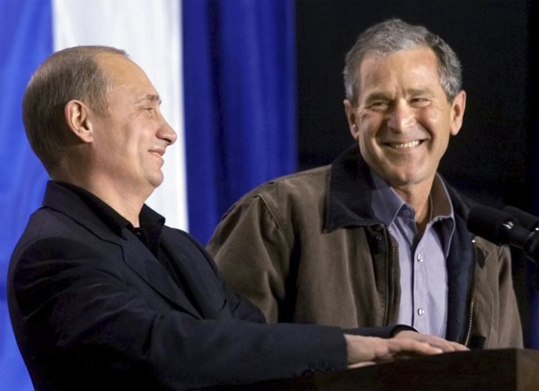 Former President George W. Bush shares a laugh with Russian President Vladimir Putin as the two answer questions at Crawford High School in Crawford, Texas, in this November 15, 2001 file photo.