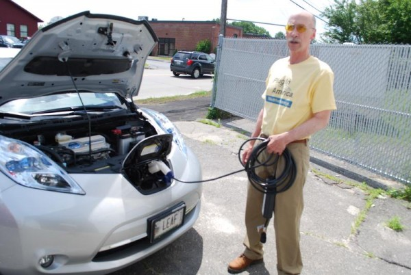 Scarborough resident Marc Lausier stands outside Revision Energy in Portland, talking about the Nissan Leaf.  Lausier purchased the first electric Nissan Leaf sold in Maine and helped promote a new Environment Maine report urging wider use of electric vehicles in Maine.