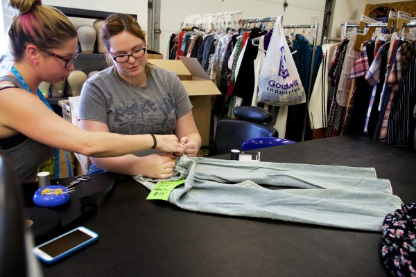 Kristin Womble, manager of Maine State Music Theatre costume shop, left, works with intern Christina Wann to install stretchy bits of fabric in a pair of jeans for an upcoming production of &quotFootloose.&quot