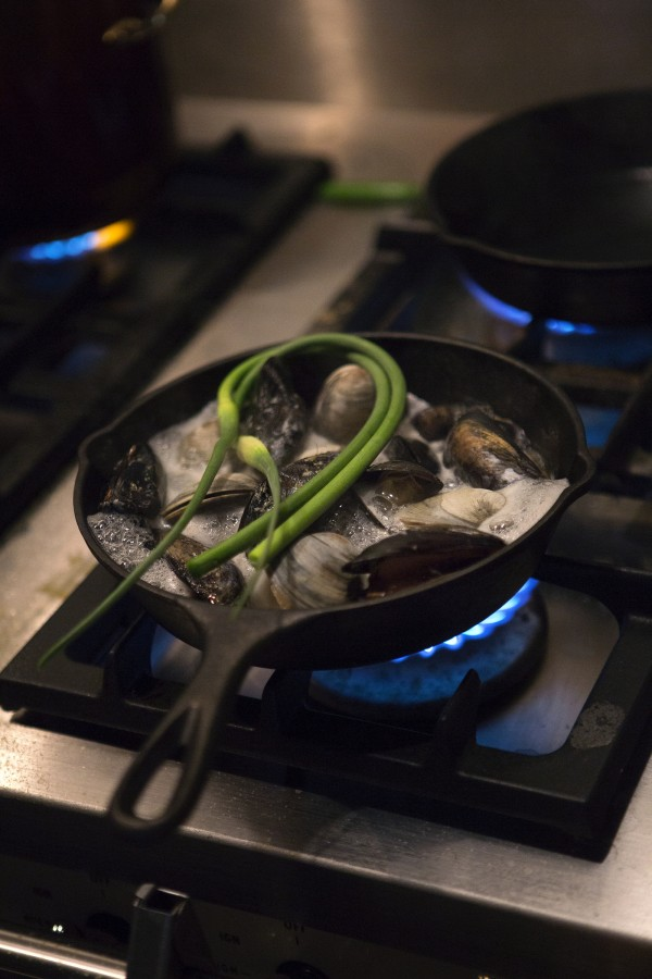 A skillet of mussels and littlenecks with cilantro, lavender and lime cooks Wednesday at The Lost Kitchen, 22 Mill Street, in Freedom.
