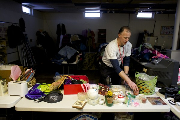 Alan Cunningham of Bangor organizes the thrift shop downstairs at The Together Place in Bangor in February.  Cunningham is in the ReFinement program, which allows people convicted of crimes to pay them back through community service.