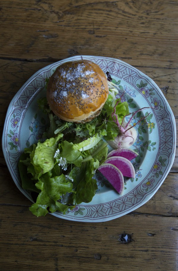 A Treble Ridge organic pork burger with blue cheese, aioli, kohlrabi and apricot slaw is seen Wednesday at The Lost Kitchen, located at 22 Mill Street in Freedom.