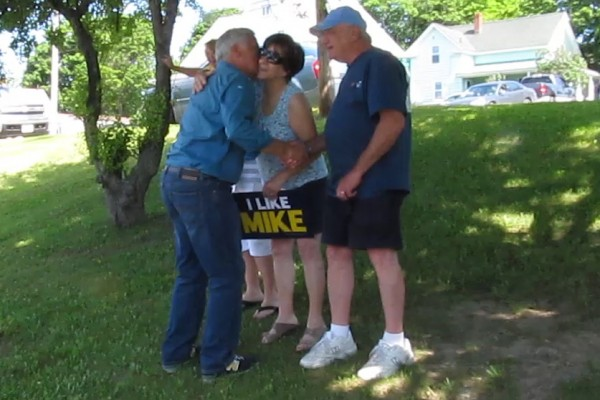 Mike Michaud, the Democratic nominee in the 2014 governor's race, greets supporters during a parade on Saturday for the East Millinocket Summerfest.