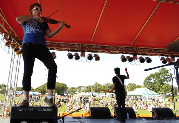 Evan James (left) of Orono, viola player and vocalist for the central Maine punk-pop band The Bay State, jams out on his viola as guitarist Tom Tash (right) of Lincoln thanks the crowd at the KahBang Music and Arts Festival on the Bangor Waterfront in 2009.