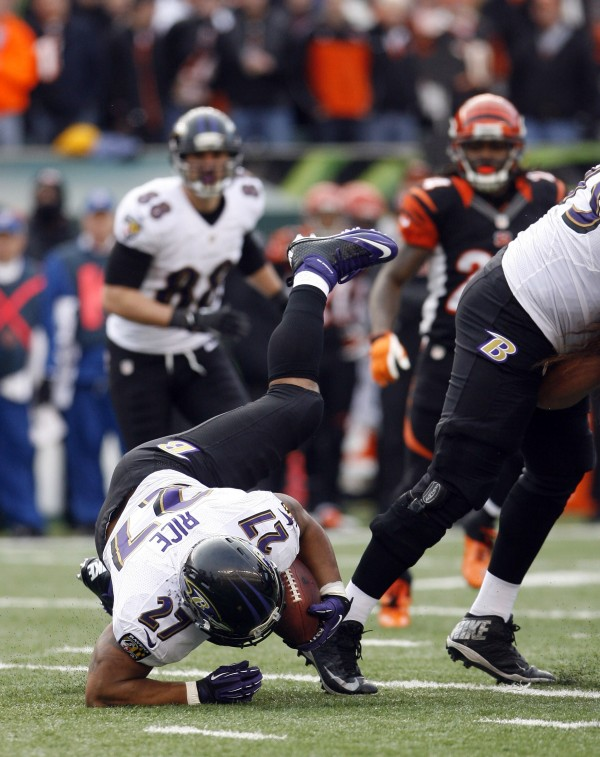 Baltimore Ravens running back Ray Rice (27) dives for a first down against the Cincinnati Bengals in the second half at Paul Brown Stadium on Dec. 29, 2013.