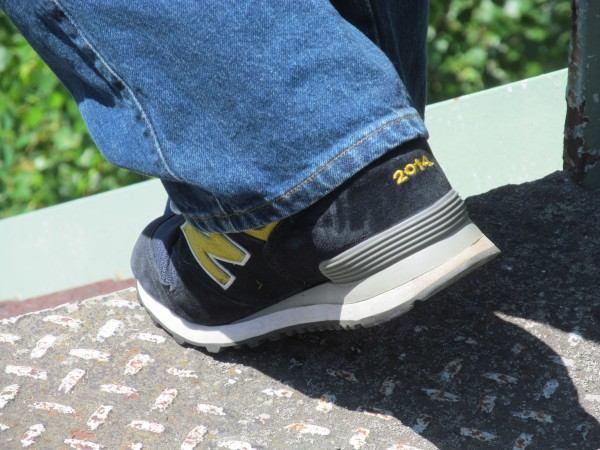 Mike Michaud wears his custom New Balance sneakers everywhere he goes, including campaigning in East Millinocket on Saturday