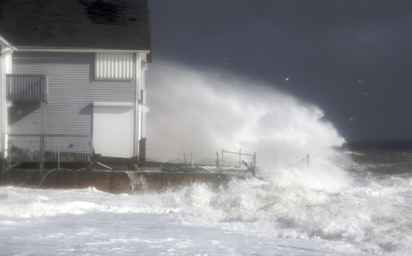 Waves crash against the shoreline during high tide in Milford, Connecticut, in this October 2012 file photo.