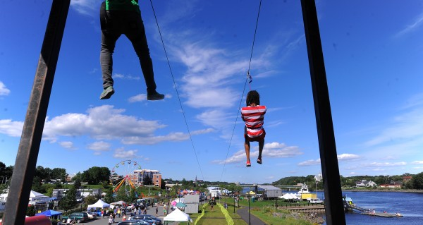People ride the zipline during the KahBang Festival in Bangor last year.