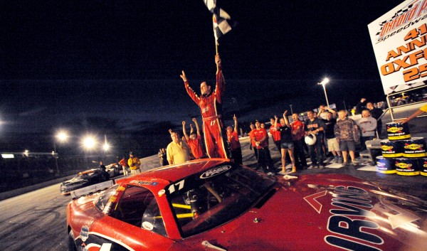 Travis Benjamin celebrates on top of his Super Late Model car after winning the OPS 250 Sunday night. This was the second win in a row for Benjamin.