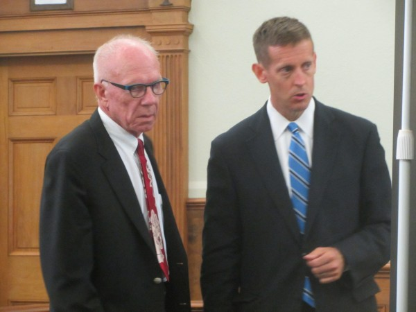 Charles Black, left, speaks with his attorney Walter McKee before closing arguments are made in Black's trial Monday in Knox County Superior Court.