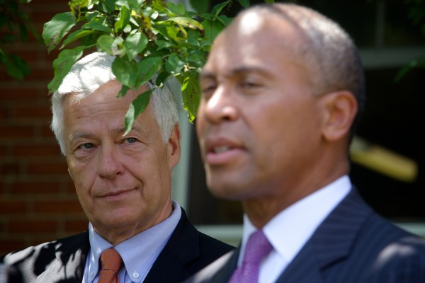Massachusetts Gov. Deval Patrick, right, takes questions with U.S. Rep. Mike Michaud following a fundraising luncheon at Portland's Cumberland Club on Monday.