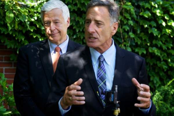 Vermont Gov. Peter Schumlin, right, takes questions with U.S. Rep. Mike Michaud following a fundraising luncheon at Portland's Cumberland Club on Monday.