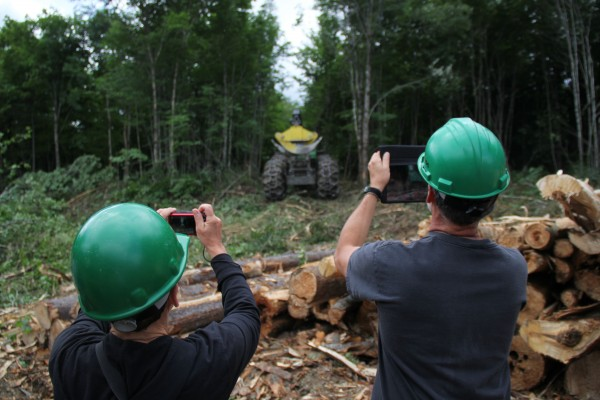 Teachers Sue Kistenmacher of the Hidden Valley Nature Center and Bill Brewington of Cape Elizabeth High School took photos and video of a tree harvest in Jackman that they will show their students.