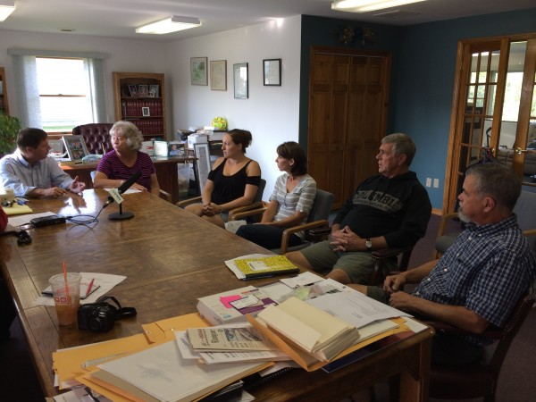Rep. Kenneth Fredette, R-Newport, left, met with six Plymouth residents on Friday to discuss odor complaints for Soil Preparation Inc.
