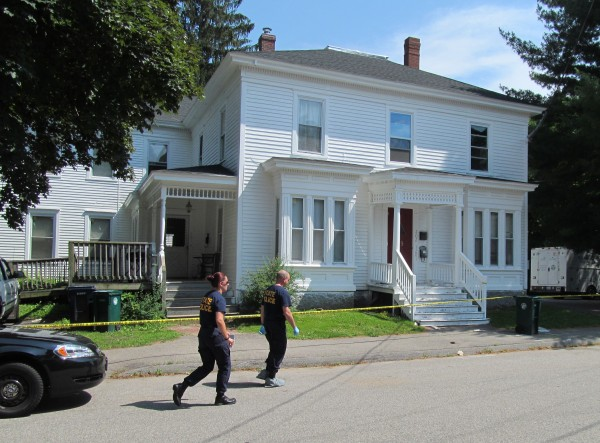 Two Maine State Police crime scene analysts approach the 19 Western Ave. building in Biddeford on Monday where two men were shot Sunday night. On Monday, police identified the victims as Russell Lavoie, 42, of Old Orchard Beach, and Jeffrey Lude, 37, of Biddeford.