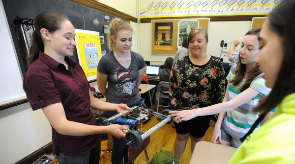 Participants of the Technology Camp for Girls at John Bapst High School look at a robot they are going to program during the five-day camp in Bangor. Pictured from left are: Karen Noble, Bethany Waanders, Kenzey Tracy, Juliet Watkins and Meg Lander.