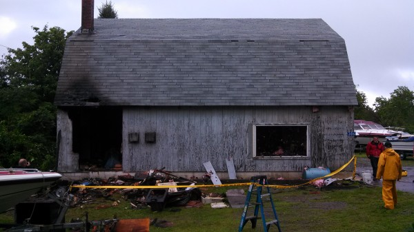 A garage at Roy's Marine Services on Bald Mountain Drive in Dedham was damaged by fire Wednesday morning.