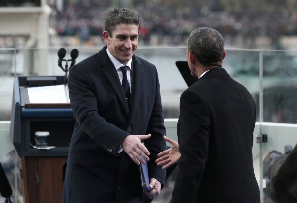 President Barack Obama (right) greets poet Richard Blanco after his reading at the presidential inauguration on the West Front of the Capitol in Washington, D.C., on Monday, Jan. 21, 2013.