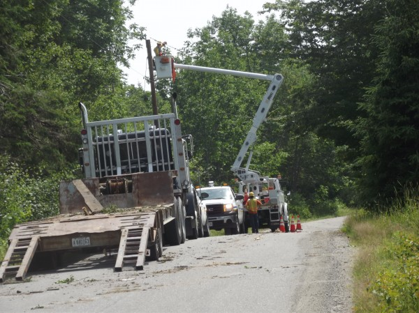 An Emera Maine crew works on Wilcox Road in Trescott on Tuesday.