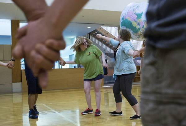 Medomak Valley's Katrina Williams (left), 15, and Charlotte Nichols, 16, try to keep a ball in the air during a team building exercise as part of the Bridge Year program Wednesday at the Recreation and Fitness Center at the University of Maine.