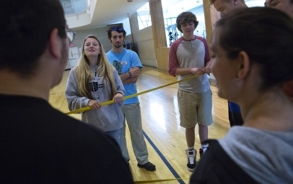 Waterville High School students close their eyes to try to make different shapes with a rope during a team building exercise as part of the Bridge Year program Wednesday at the Recreation and Fitness Center at the University of Maine.