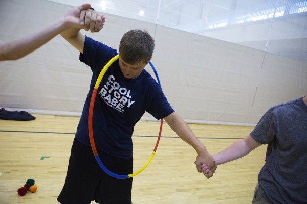 Medomak Valley's Justin Bowman, 16, moves a hula-hoop over his body during a team building exercise as part of the Bridge Year program Wednesday at the Recreation and Fitness Center at the University of Maine.