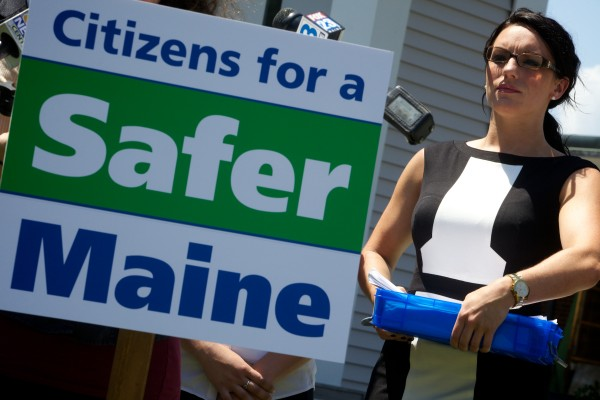 Erin Mancini clutches petitions as marijuana advocates hold a press conference and turn in 1,521 signatures seeking a legalization referendum at City Hall in South Portland on Monday.